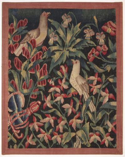 "A mille fleurs tapestry fragment, Southern Netherlands, circa 1500-1540 35¾"" (91cm) high and 28½"" (72.5cm) wide"