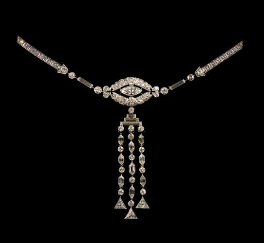 An elegant Art Deco period diamond set necklace with detachable pendant drop. The diamonds have an estimate total weight of 12 carats and combine five different diamond cuts. Mounted in platinum. Circa 1925.