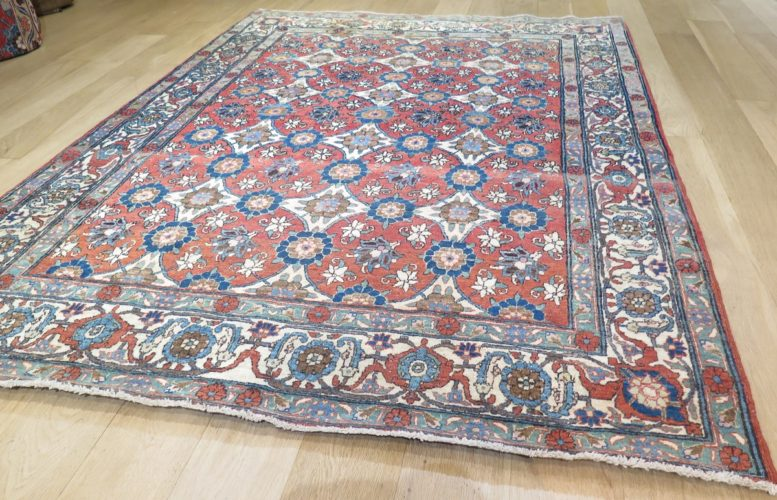 Antique Veramin rug from central Persia Size: 2.02 x 1.46 metres - 6'7 x 4'8 feet Dating first quarter 20th century, a stylish example with a light terracotta field and a pleasant spacious drawing framed by a wide ivory border.