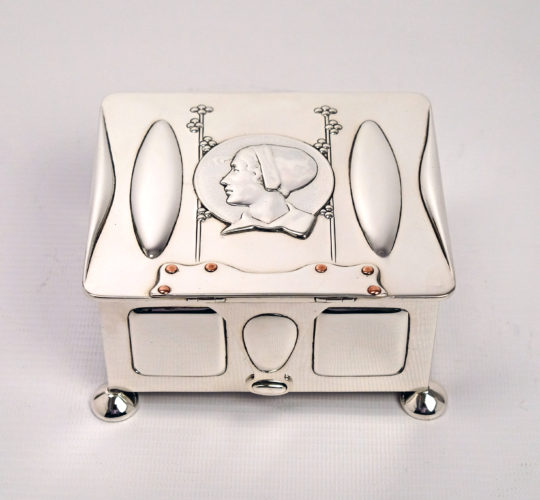 An Art Nouveau box designed by Kate Harris and made in 1900 by W. G. Connell of London. Sterling silver with copper rivets.