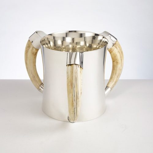A rare stunning & heavy gauge silver Champagne or wine cooler supported by 3 wild boar tusk handles. Date: 1908 Maker: William Hutton & son (London) H: 8