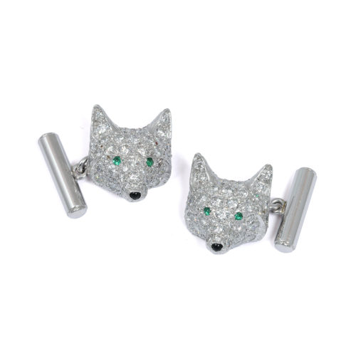 Diamond fox head cufflinks set in platinum with emerald eyes and onyx nose. Circa 1980