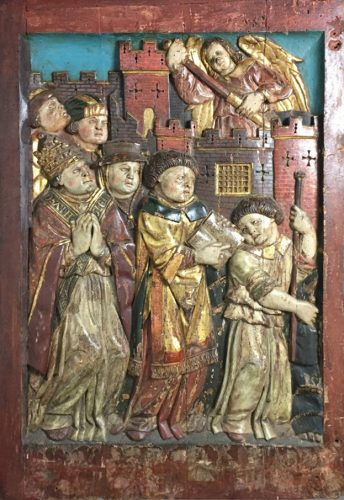 A very well carved Continental panel, retaining its original polychrome decoration (c.1450)