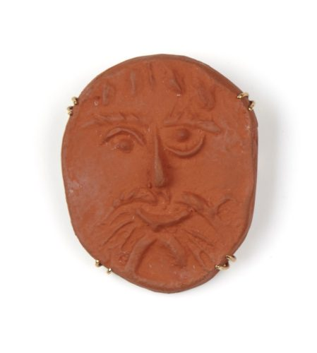 Pablo Picasso Visage (1954/1955) Terracotta oval medallion with a stylised face in low relief