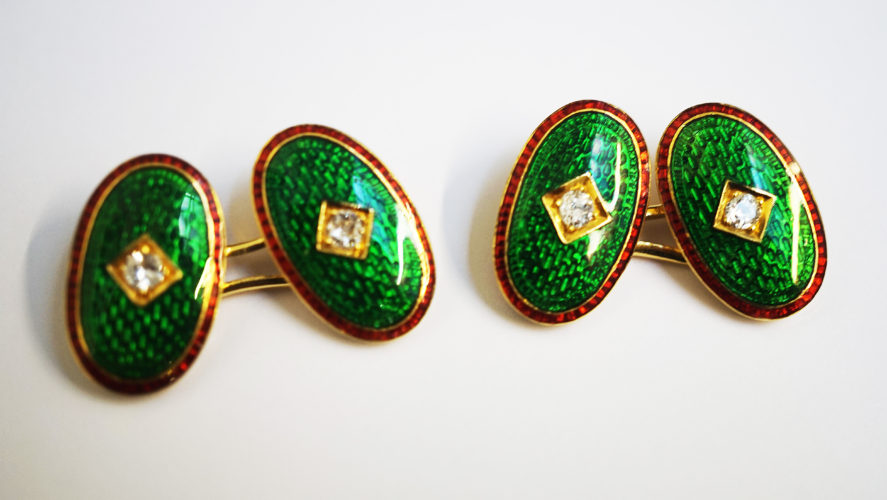 Pair of 19th century red and green enamel cufflinks with a central diamond, English
