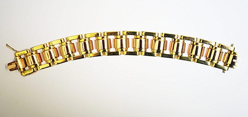 A heavy quality 18kt yellow and rose gold panel bracelet c.1950