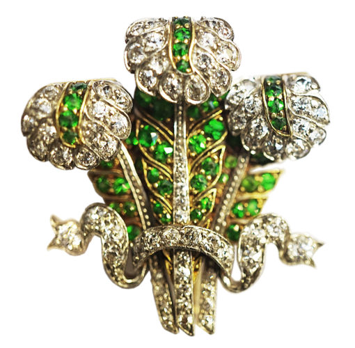 A fine19th century green garnet and diamond Prince of Wales feathers brooch, mounted in silver and gold, c.1900