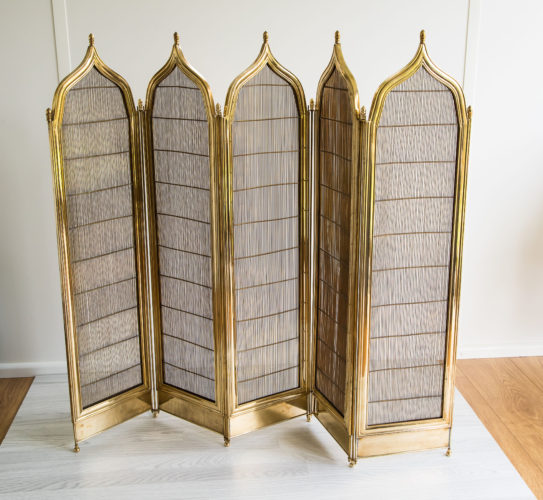 An exceptional five-fold fire screen in brass with a Gothic influence to the shaped top. French c.1900.