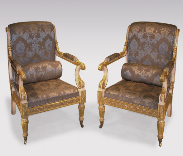 An impressive pair of early 19th Century Regency period white painted and carved giltwood Armchairs, acanthus and scroll carved throughout.