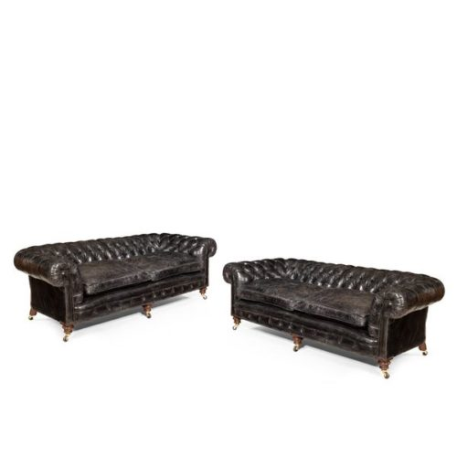 A Pair of Victorian three seater walnut Chesterfield sofas