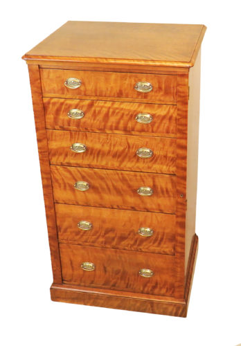 A Stunning & Exceptional Quality 19th Century Maple And Mahogany Wellington Chest Having Superbly Figured Top Over Six Graduated Drawers With Replacement Brass Handles Flanked By Locking Pilaster Raised On Original Plinth Base