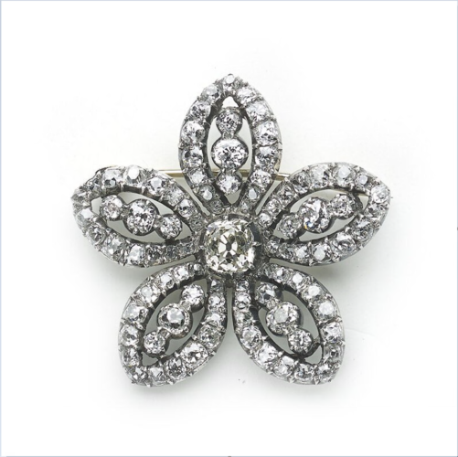 A Georgian, diamond, five petalled flower brooch, set with approximately 12.50ct of old-cut diamonds, in closed backed, silver, cut down settings, English, circa 1785.