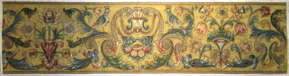 An Italian embroidered hanging, circa 1700, worked in couched and appliquéd silk. 2'4½