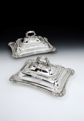 "A fine and exceptionally heavy pair of late George III Entree Dishes with cover, shaped rectangular gadroon borders, bold leaf and shell corners, naturalistic handles with acorn and oak-leaf mounts, engraved with armorial and crests, probably for Sir John Delves Broughton, 7th Baronet. Measuring 12.2"" (31cm) by 9.5"" (24 cm) across dishes, weight of pair 157oz (4889g). Hallmarked London 1819, maker Paul Storr"