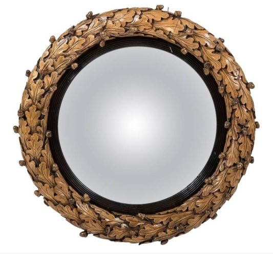 Regency convex mirror, frame carved with oak leaves & acorns, by Jeremiah Freeman.