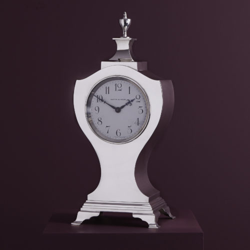 An antique sterling silver mantelpiece clock, hallmarked in London in 1911 by Mappin & Webb