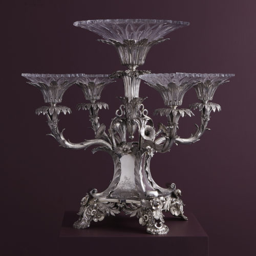 An antique sterling silver and glass Epergne, hallmarked in Birmingham in 1834 by Robinson, Edkins and Aston.