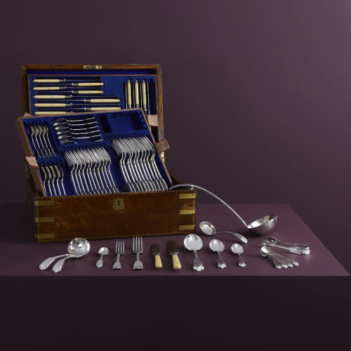 An antique sterling silver cutlery set in the original box. One of over 300 sets in stock.