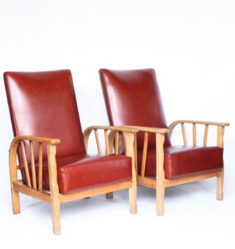 A pair of Arts & Crafts reclining lounge chairs with oak, ash and beech frames. Re-upholstered in old English chestnut leather. Origin: English Date: Circa 1910.