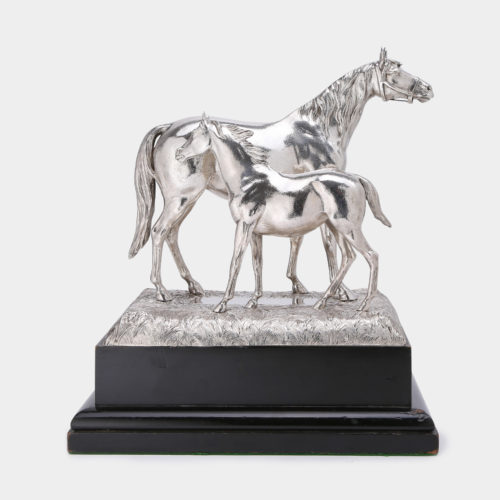 Silver sculpture of a mare and her foal, made by Goldsmiths & Silversmiths Company of London in 1938.