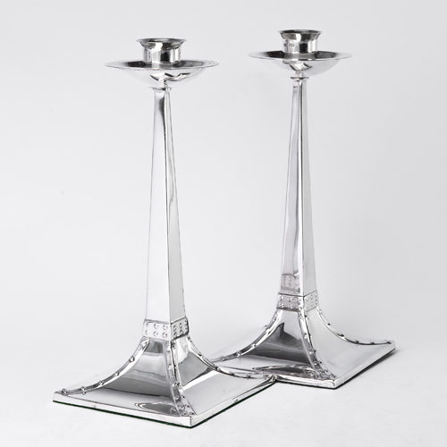 Pair of silver Arts & Crafts style candlesticks by James Dixon of Sheffield in 1904.