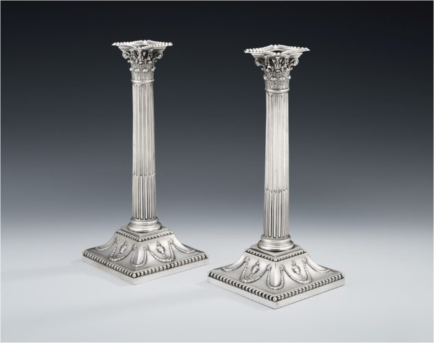 A pair of George III Neo Classical Candlesticks made in Sheffield in 1775 by John Winter & Company.