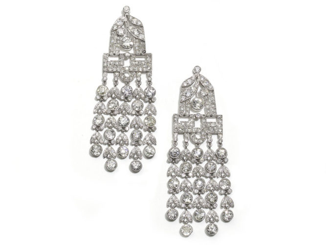 A pair of French, Art Deco, diamond drop earrings, set with old-cut and rose-cut diamonds, in grain and rub over settings, with millegrain edges, each with five tassels of alternating diamonds and double leaves, mounted in platinum, circa 1930.
