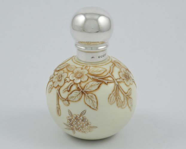 Victorian silver topped simulated 'Ivory' cameo glass perfume bottle by Thomas Webb marked for London 1885.