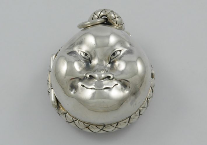Rare Victorian novelty silver sovereign case marked for London 1883, in the form of a Japanese Noh mask by Louis Dee.