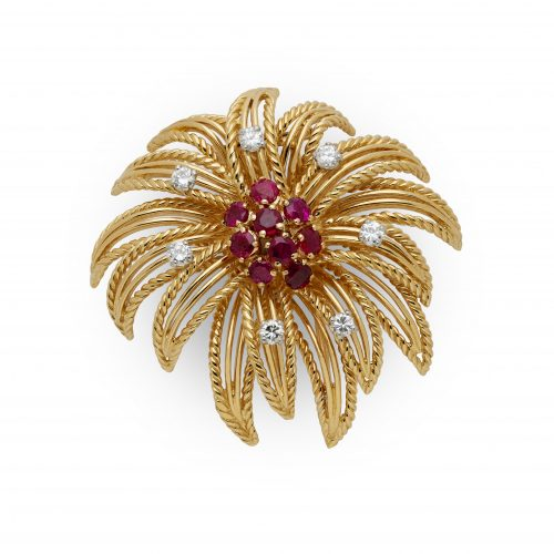 A stunning 18ct yellow gold rope twist 'Firework' brooch set with rubies and diamonds signed by Boucheron made in France circa 1980