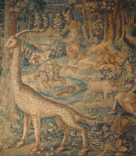 A fine tapestry panel. Brussels, circa 1560-1580. Worked in silks and wools with a woodland scene populated with a giraffe, huntsmen on horseback, and the image of the virgin and unicorn. The form of the giraffe appears to be based on the woodcut used to illustrate Konrad Gesner's 'Historiae animalium' of 1551–1558. 6'10