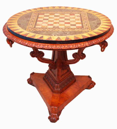 An Extremely Unusual William IV Period Satinwood Circular Centre Table Having Attractive Pietra Dura Marble Chess Board Top Raised On Well Figured Tripartite Central Column With Scrolling Supports And Carved Decoration Terminating On Plateau Base With Carved Claw & Ball Feet