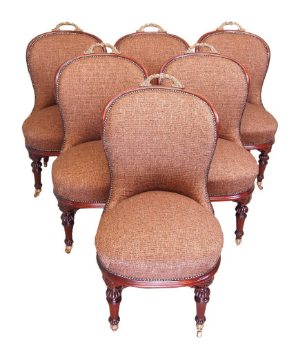 An Extremely Unusual And Very Good Quality Set Of Six 19th Century Walnut Salon, Or Dining, Chairs Having Superb Quality Original Brass Carrying Handles To Tops And Carved Decoration Raised On Elegant Turned Legs And Brass Castors