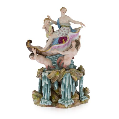 A Meissen group of Venus Rising, circa 1880. After the model by J.J.Kaendler, the figures of Venus accompanied by Cupid seated in a shell supported by three Triton, rising from the sea, the rocky base applied with waterfalls from the current, 34.5 cm high.