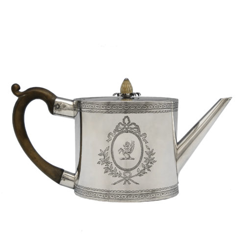 An antique, George III, sterling silver drum shaped teapot, hallmarked in London in 1775.