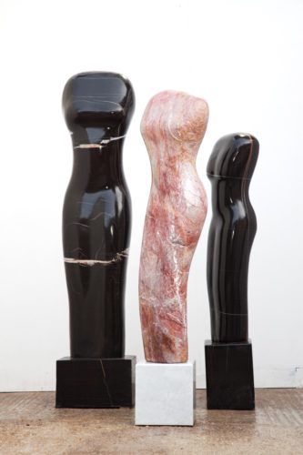 Left to right: Crystal Veined Torso, 2017 Moroccan Black Marble 200 x 40 x 40 cms 78 3/4 x 15 3/4 x 15 3/4 ins Stoneycombe Torso, 2018 Stoneycombe marble on a Carrara marble base 200 x 34 x 32 cms 78 3/4 x 13 3/8 x 12 5/8 ins Small Moroccan Torso, 2018 Moroccan Black marble 170 x 40 cms 66 7/8 x 15 3/4 ins