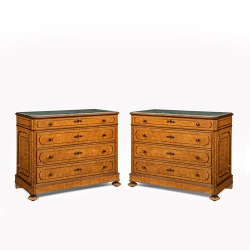 A pair of bird's eye maple commodes by Zignago & Picasso, each of rectangular form with cut corners and four drawers, with the original grey marbles set into the top, decorated with solid kingwood mouldings, handles and key plat W, signed on the lock Zignago & Picasso, Italian, c1880.