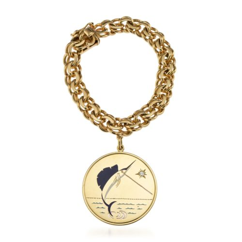 Cartier signed and numbered bracelet with Cartier pendant attached Circa 1960's