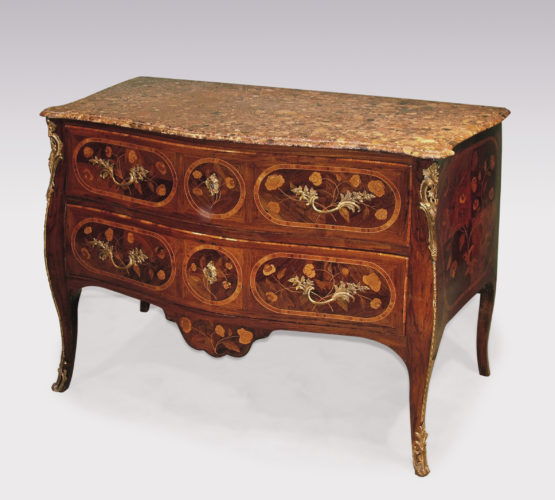 An unusual mid-18th century Portuguese serpentine, rosewood, tulipwood crossbanded, floral marquetry commode, having moulded edge