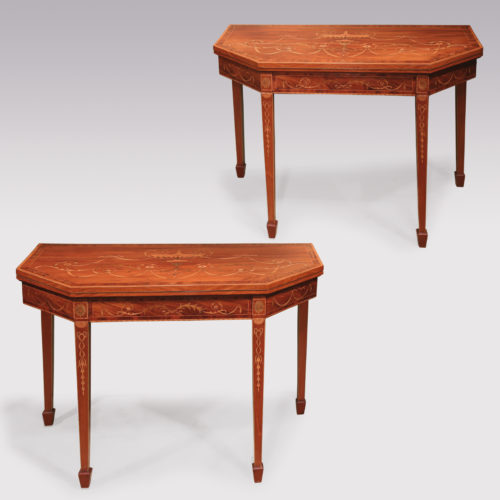 A fine quality pair of late 18th Century Sheraton period figured mahogany canted cornered Card Tables boxwood strung and crossbanded throughout, having ornate urn, swag, ribbon, leaf & flower penwork inlays, supported on square tapering legs ending on spade toes. Circa 1790.