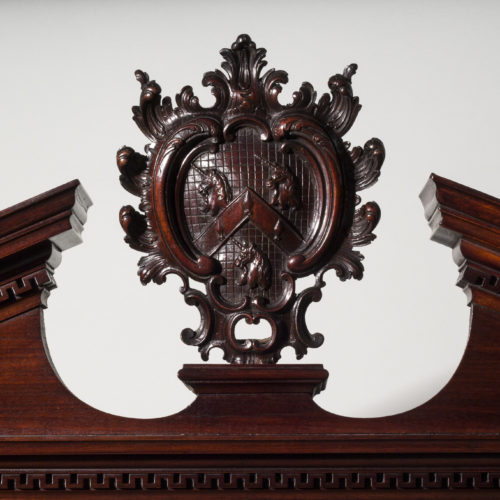 Detail of an important Chippendale period mahogany bookcase, bearing the coat of arms of the Wrights family of Nottingham, circa 1750.