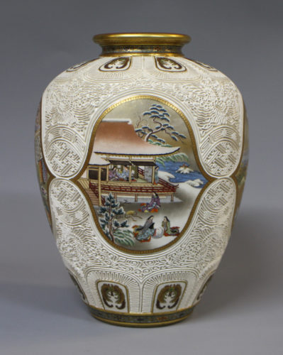 A fine and rare Japanese satsuma vase with carved decoration and painted seasonal panels, signed Kinkozan, c1880, 25cm high