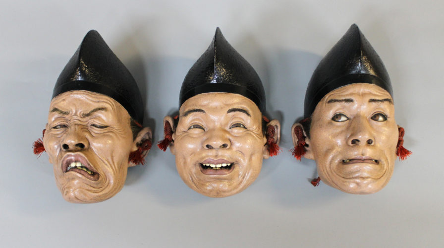 Three realistic grotesque Japanese lacquer masks, c1880, approx 18cm high