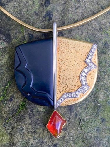 Andrew Grima gold, onyx and opal pendant on a GRIMA tork, Signed Grima.
