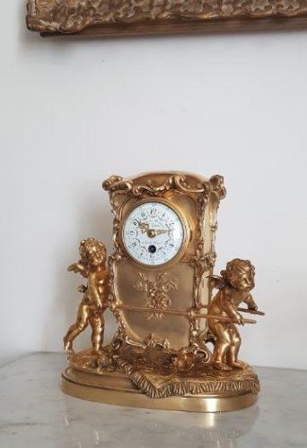 Rare mantel timepiece of sedan chair form, the bronze signed Aug. Moreau